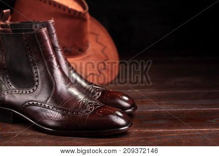 Brown Leather Chelsea Boots Polished With Leather Hat.selective Focus. Waxing Boots.copy Space.close