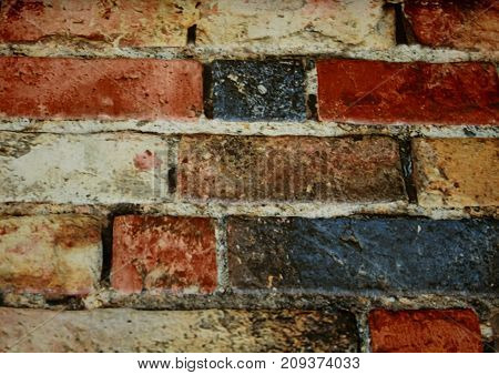 The wall of colored brick is decorative