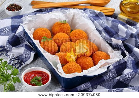 Saffron Rice Balls Stuffed With Cheese