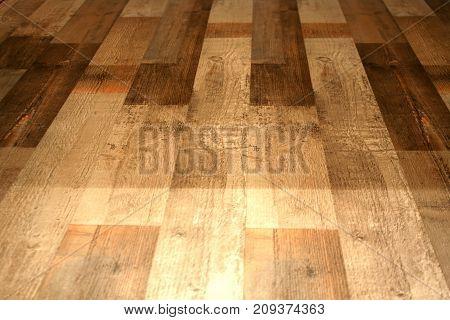 Laminate flooring under natural wooden boards on the floor.