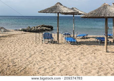 CHALKIDIKI, CENTRAL MACEDONIA, GREECE - AUGUST 25, 2014: Seascape of Blue Dolphin Cove Beach at Sithonia peninsula, Chalkidiki, Central Macedonia, Greece