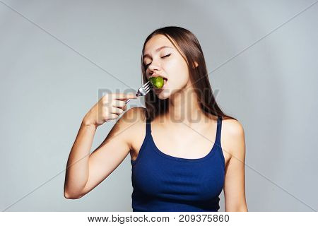 a young girl wants to lose weight so she eats a low-calorie cucumber
