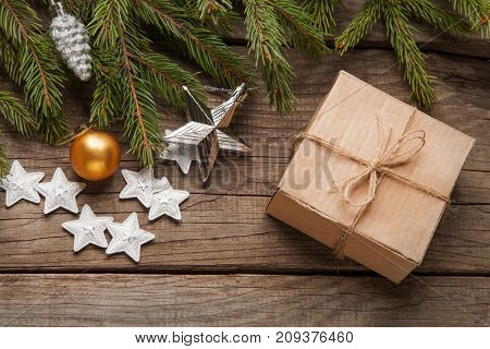 Christmas tree with gift box and decorations on wooden background copy space for lettering