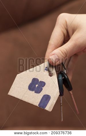 Female Hand Holding House Key,real Estate Agent