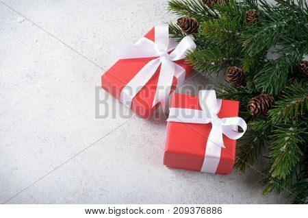 Two christmas gift boxes with bows on a light-blue stone background top view copy space