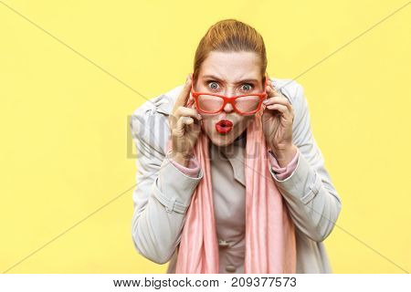 Redhead Woman Wearing Coat, Opening Mouths Widely, Having Surprised Shocked Looks.