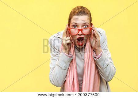 Shocked Woman Wearing Coat, Pink Scarf, Opening Mouths , Having Surprised Shocked Face.