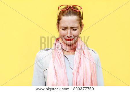 Portrait Of Unhappy And Depressed Young Caucasian Woman With Ginger Hair Feeling Ashamed Or Sick. Hu