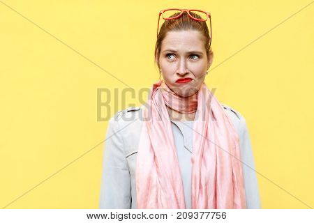 Portrait Ginger Girl At Autumn. Wearing In Coat And Pink Scarf, Red Sunglasses And Thinking. Isolate