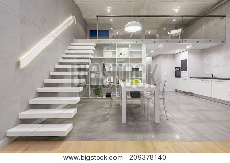 Apartment With White Staircase