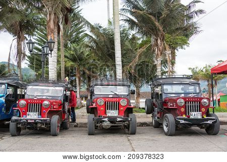 SALENTO COLOMBIA - JUNE 6: Row of red Willys Jeeps in Salento Colombia on June 6 2016