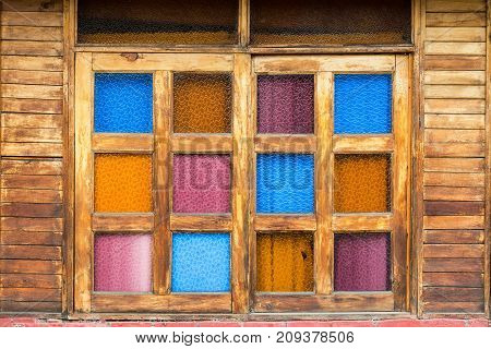 View of a colorful window on a rustic wooden building in Salento Colombia