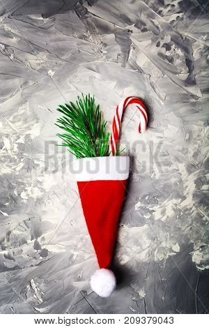 Christmas And New Year Concept With Red Santa Hat, Fir Tree And Candy