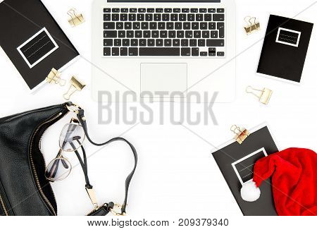Fashion flat lay for social media. Feminine working place with Christmas decoration on white background