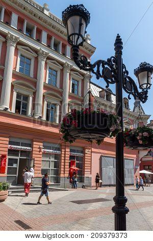 PLOVDIV, BULGARIA - SEPTEMBER 1, 2017:  People walk down a Knyaz Alexander I street in city of Plovdiv, Bulgaria
