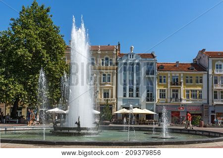 PLOVDIV, BULGARIA - SEPTEMBER 1, 2017:  Amazing view of cental street and fountain in front of City hall in city of Plovdiv, Bulgaria