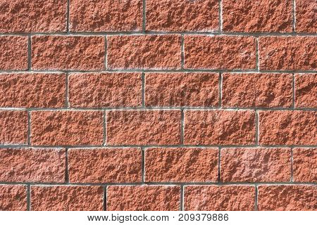 Close-up view of a new, red brick wall background