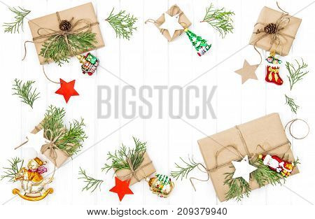 Christmas gift boxes and decoration on wooden background