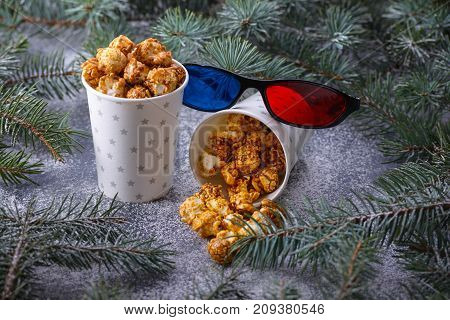 Popcorn And 3D Glasses In Christmas Decor On Table