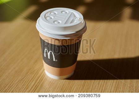KALININGRAD, RUSSIA - CIRCA OCTOBER, 2017: close up shot of McDonald's disposable paper coffee cup. McDonald's is an American hamburger and fast food restaurant chain.