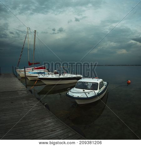Boats Moored To The Dock After Sunset