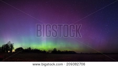 Bright Aurora In Russia, Outside The City