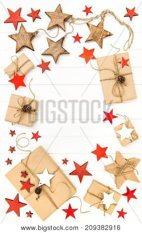 Gifts with christmas decoration and stars on bright wooden background. Flat lay