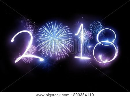 The year 2018 displayed with fireworks and strobes. New year and holidays concept.