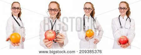 Pretty female doctor with stethoscope and orange isolated on whi