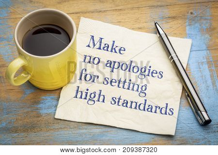 Make no apologies for setting high standards - handwriting on a napkin with a cup of espresso coffee