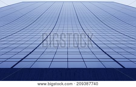 Facade of tall blue skyscraper, modern office building, view from bottom