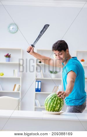 Man eating watermelon at home