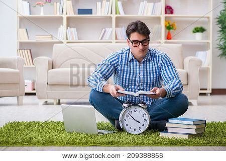 Young handsome man sitting on floor at home