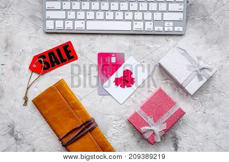 order new year 2018 present with sale with credit card on gray stone table background top view