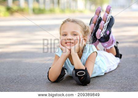 Cute little roller skater in park