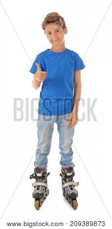 Cute little boy on roller skates against white background