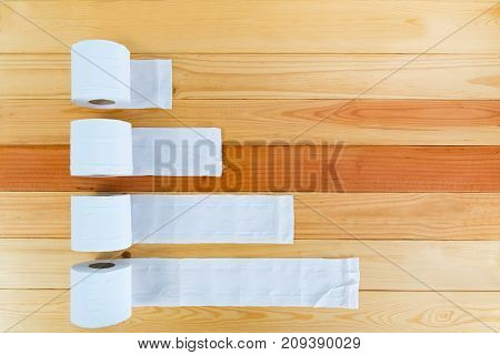White Tissues Paper Or Toilet Paper On Wooden Table.