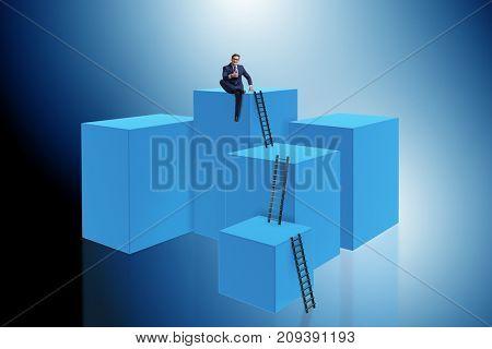Businessman climbing blocks in career ladder business concept