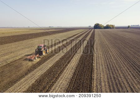 Automated GPS navigated tractor working on field