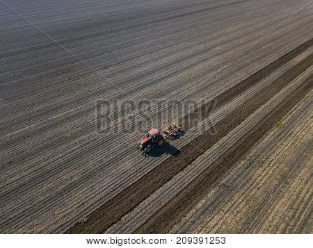 Farmer preparing land for sowing