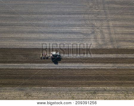 Harrowing field with tractor