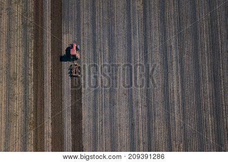 Farmer working on field with tractor