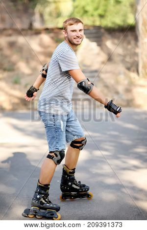 Young man rollerskating in park