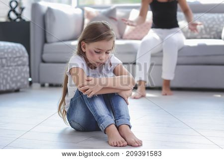Woman scolding her daughter at home. Domestic violence concept