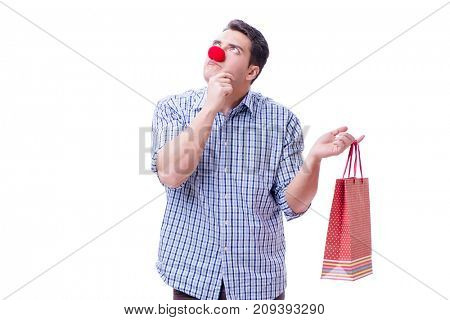 Man with a red nose funny holding a shopping bag gift present