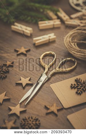 Christmas. Vintage Style Scissors And Gift Boxes On A Rustic Wooden Table