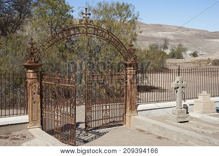 Tiliviche, Tarapaca Region, Chile - August 30, 2017: Historic British Cemetery from the era of nitrate mining in the Atacama Desert, in the grounds of Hacienda Tiliviche in northern Chile.