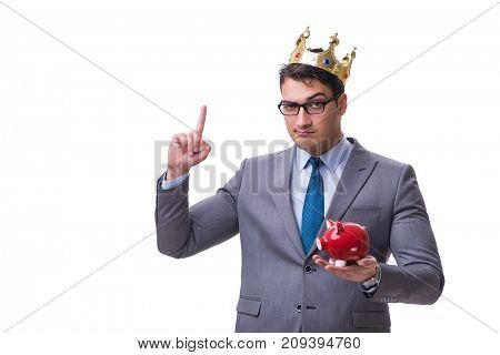 King businessman holding a piggy bank isolated on white backgrou