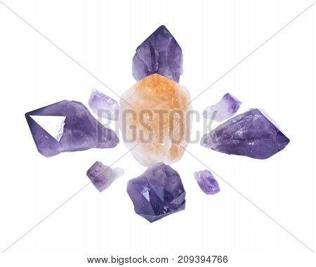 Amethyst and citrine natural points arranged in crystal grid isolated on white background