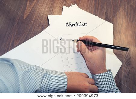 Blank Checklist On Wooden Table A Sheet Of Paper In Front Of A Man With The Words: Check List . Plan